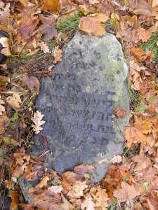 "The rough boulder-style matzevah of an elderly woman, ""Bashe(?) daughter of Eliezer (d. c. 1900). Bagnowka Cemetery, section 49."